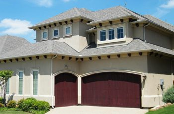 Spanish style house with garage